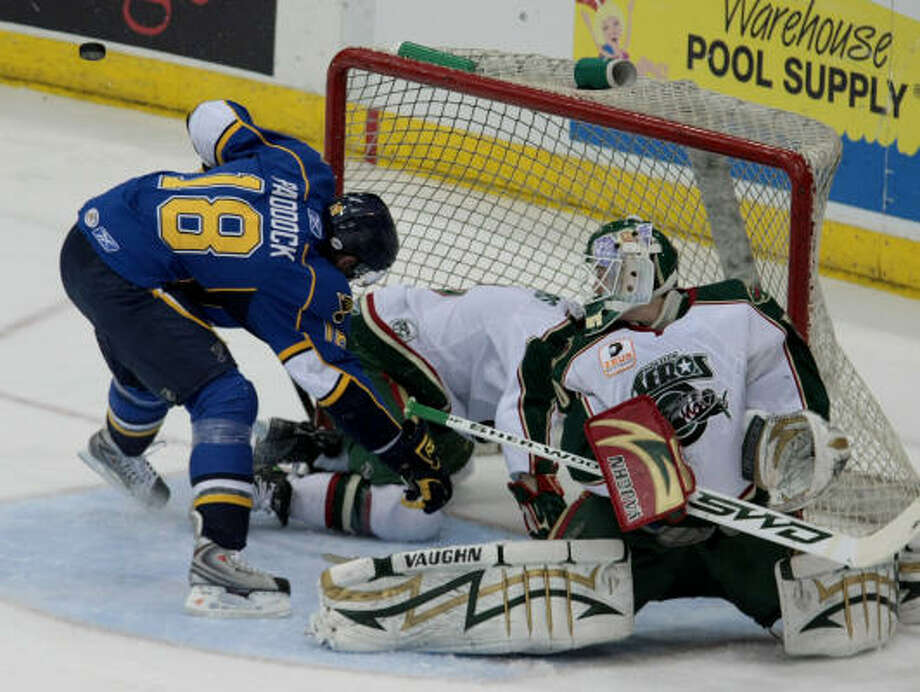 Aeros goalie Anton Khudobin (right) makes a save while Peoria's Cam Paddock (18) crashes the net in the first period of Game 4 of the West Division semifinals Monday at Toyota Center. Peoria won 4-3 to even the series at two games apiece. Photo: Thomas B. Shea, For The Chronicle
