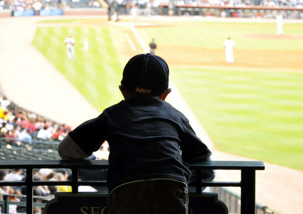Jimmie Brannen checks out the game from the railing by the right field foul pole.