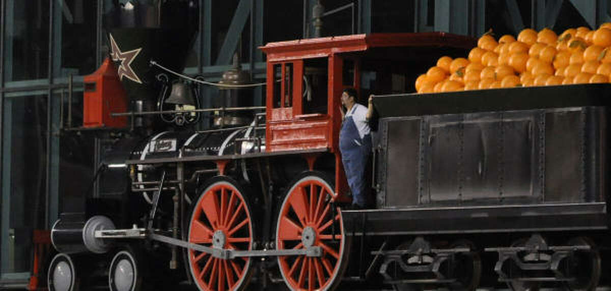 The Astros' train conductor follows the action from his giant, orange-carrying choo-choo.