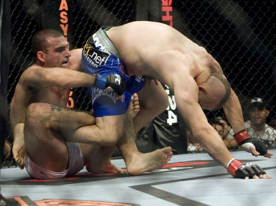 "Mauricio ""Shogun"" Rua, left, gets a hold on Chuck Liddell during their light heavyweight fight at UFC 97 in Montreal. Photo: Ryan Remiorz, AP"