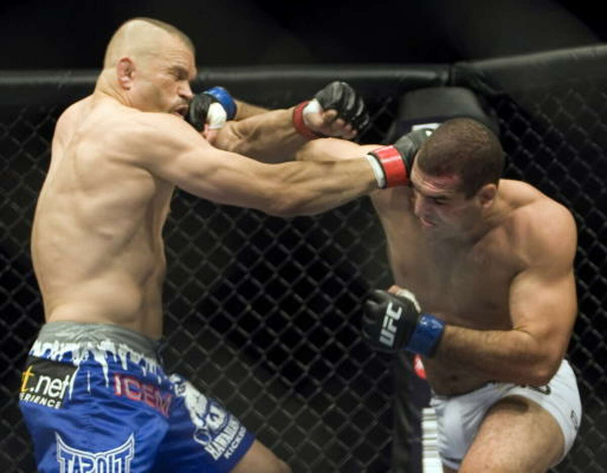 Chuck Liddell, left, takes a right to the face from Mauricio