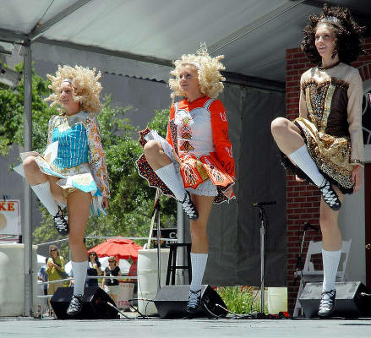 From left, Hannah Cass, Laura Cass and Lindy Cass of the Cass Academy of Irish Dance perform.