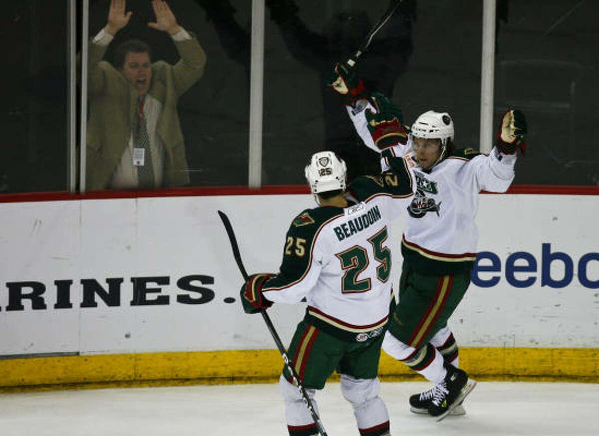 The Aeros' Corey Locke (right) celebrates his second-period goal with Matt Beaudoin.