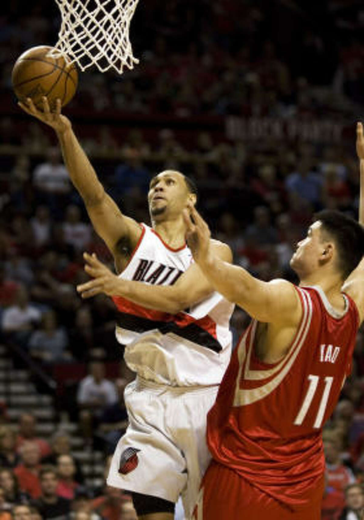 Trail Blazers guard Brandon Roy, left, goes to the hoop as Yao Ming defends during the first half.