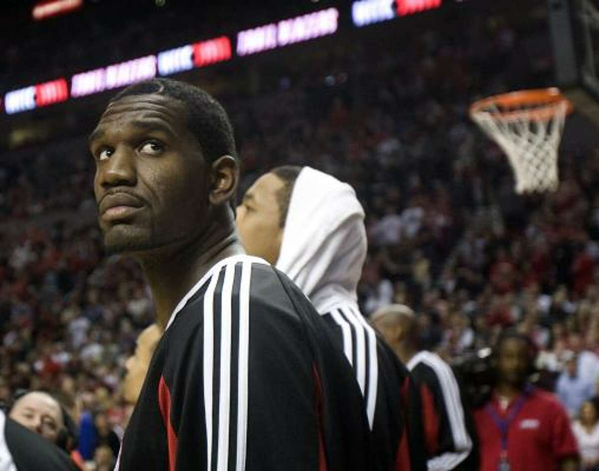 Trail Blazers center Greg Oden stands on the sideline before Game 1.
