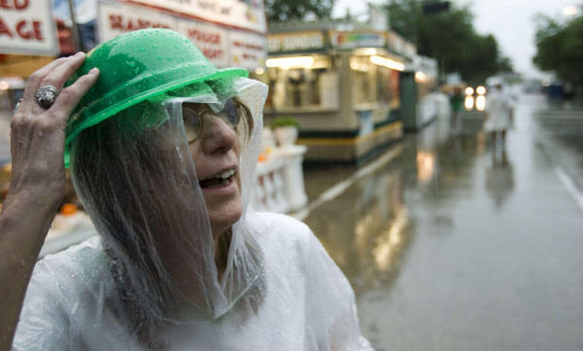 Linda Grasser holds on to her hat as she leaves the International Festival.