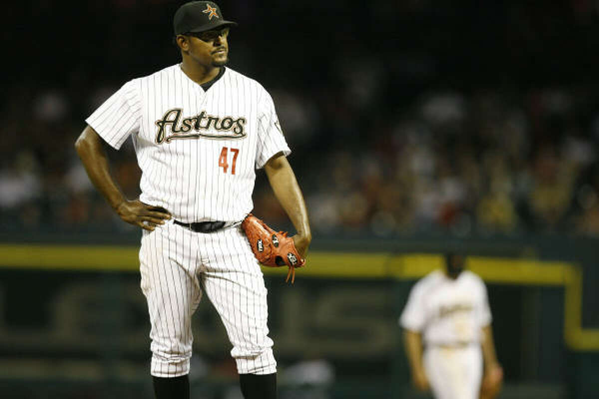 Astros closer Jose Valverde (47) waits for the Reds to finish celebrating after he gave up a two-run homer to Ramon Hernandez in the ninth inning.
