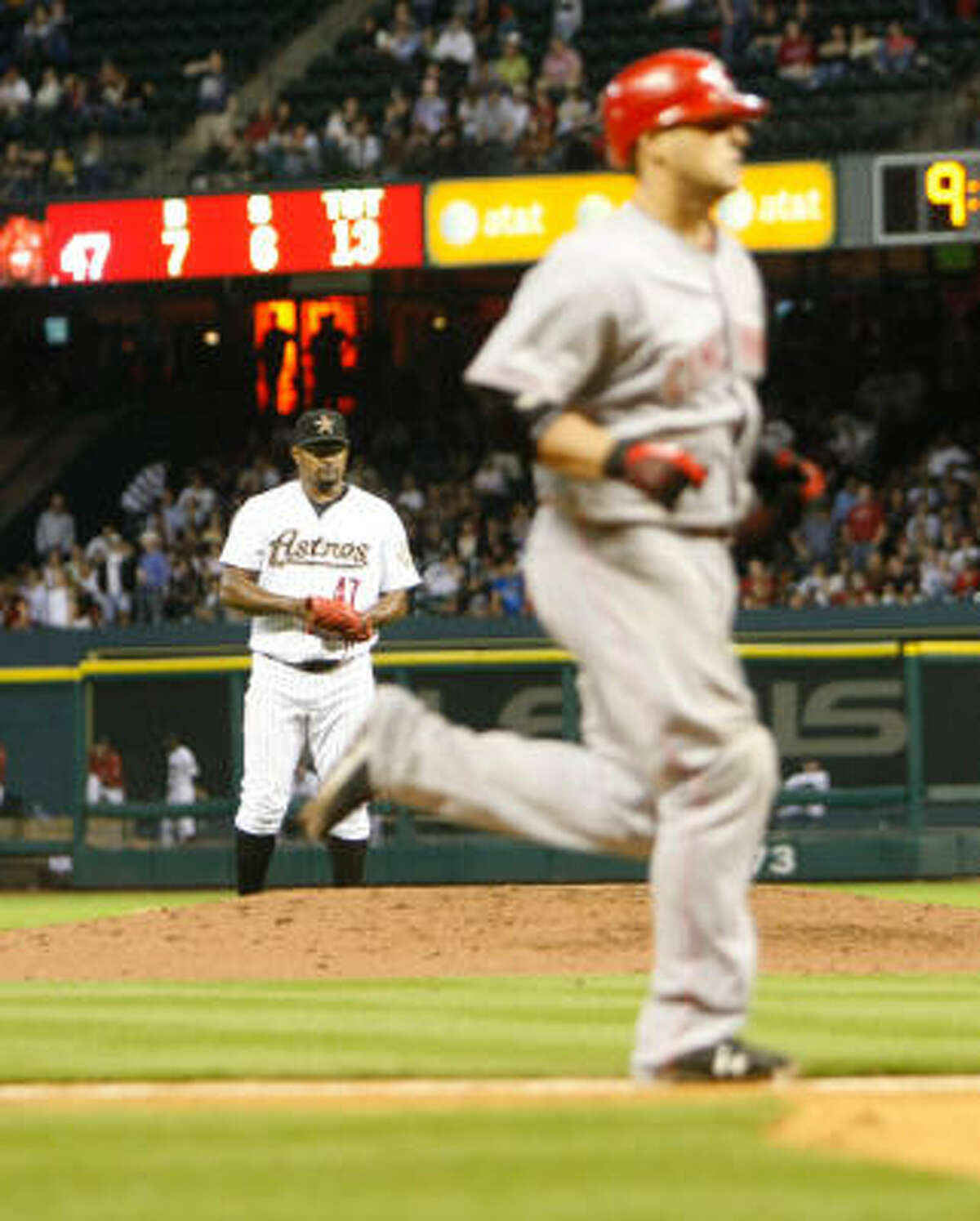 A dejected Jose Valverde, rear, watches Cincinnati Reds catcher Ramon Hernandez sprint home after hitting a two-run homer in the ninth inning.