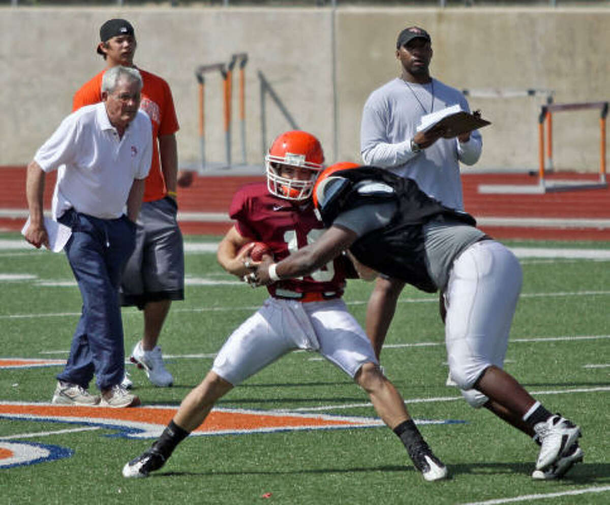 Quarterback Jeff Welch is tackled during spring practice.