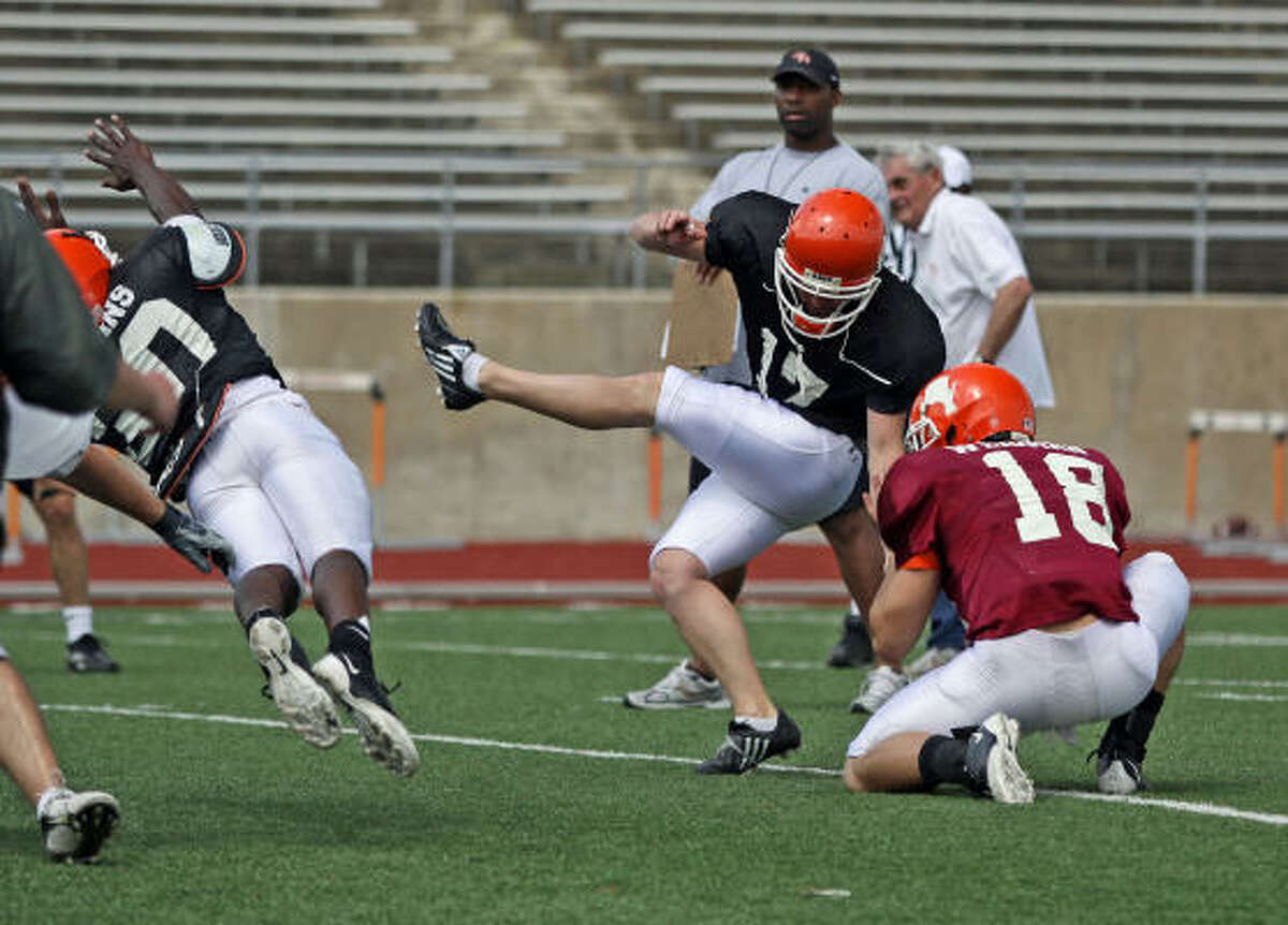 Taylor Wilkins attempts a field goal during spring practice at Bowers Stadium.
