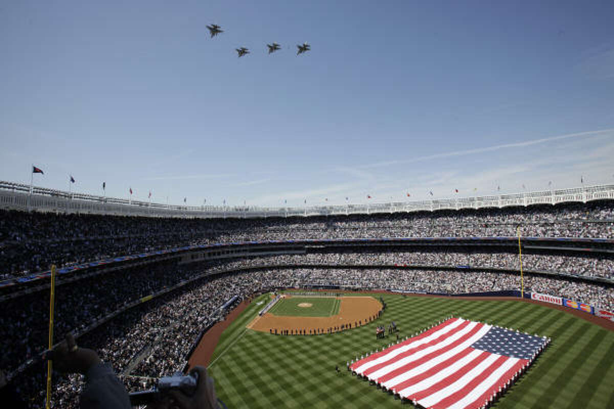 Fighter jets fly over the new Yankee Stadium during pregame ceremonies.