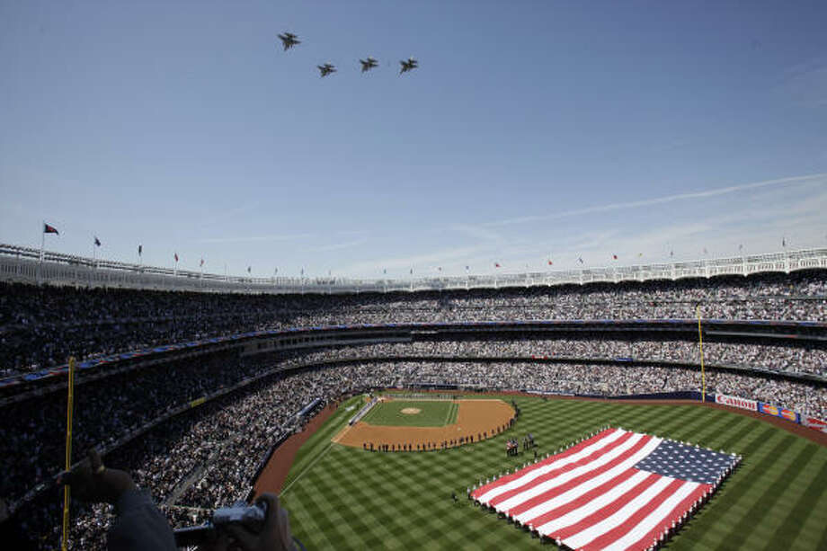 Fighter jets fly over the new Yankee Stadium during pregame ceremonies. Photo: Kathy Willens, AP