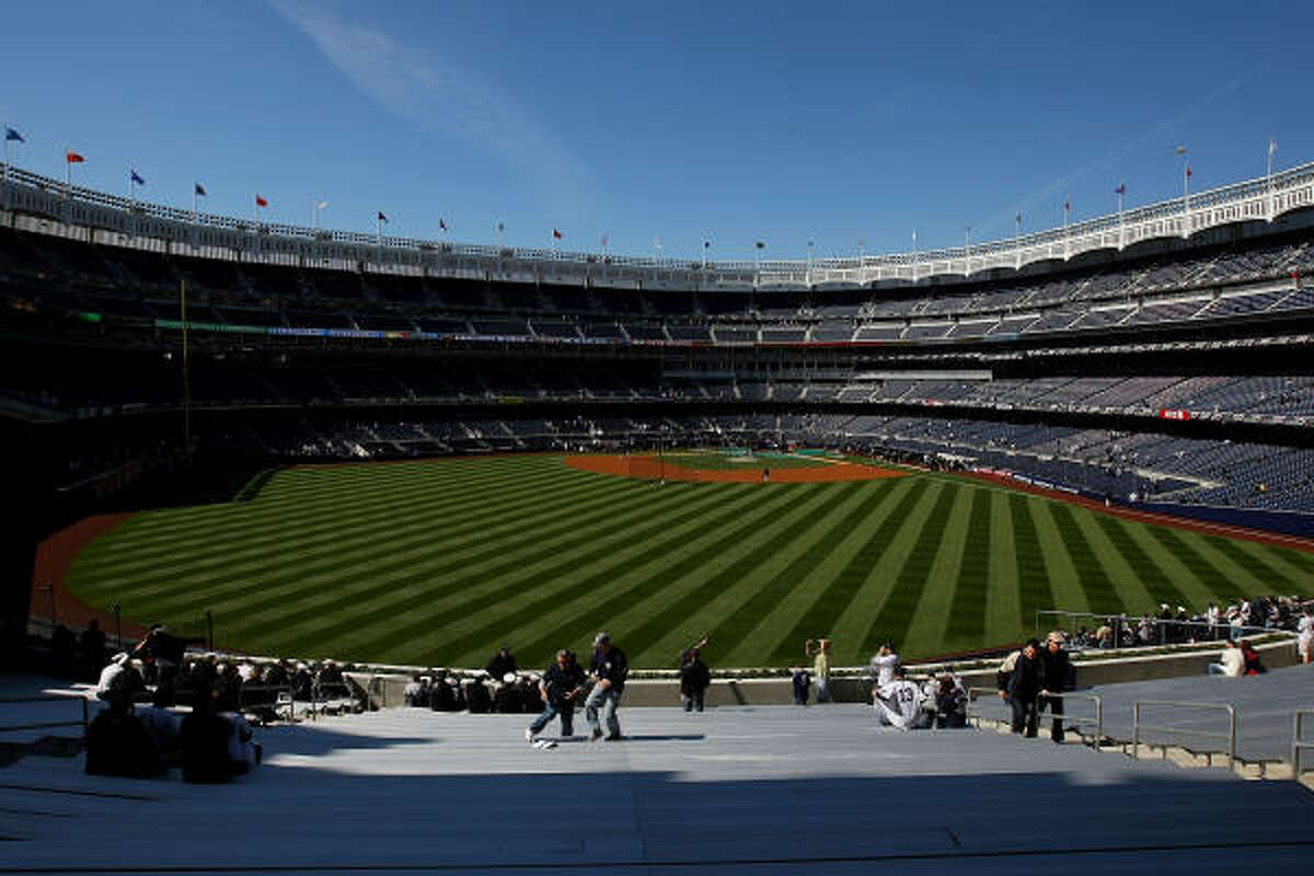Fans look on from the outfield stands during batting practice before the opening day game between the Cleveland Indians and the New York Yankees at the new Yankee Stadium.