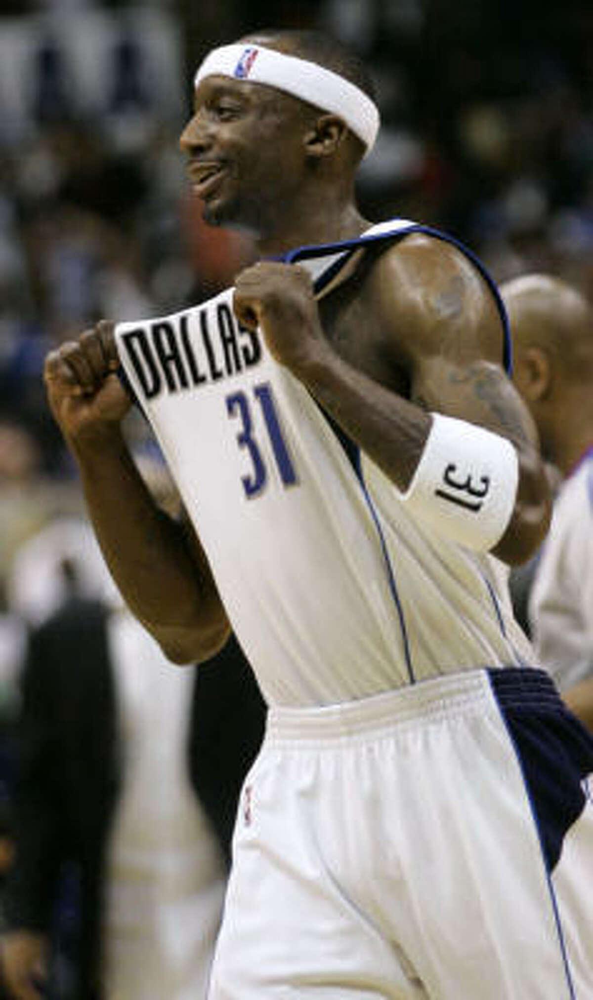 Dallas Mavericks guard Jason Terry celebrates at the end of the Mavericks' win over the Rockets.