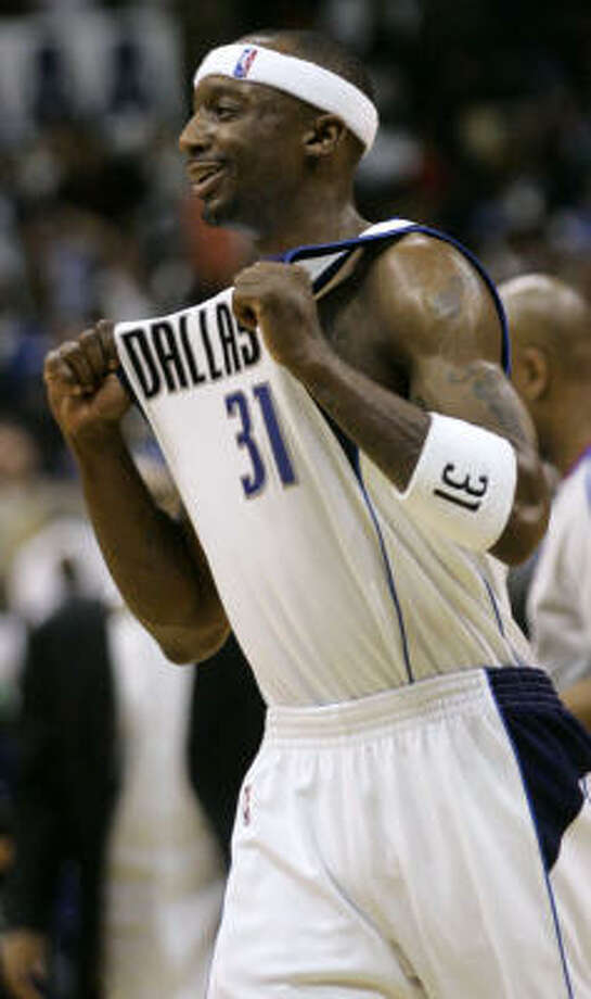 Dallas Mavericks guard Jason Terry celebrates at the end of the Mavericks' win over the Rockets. Photo: Donna McWilliam, AP