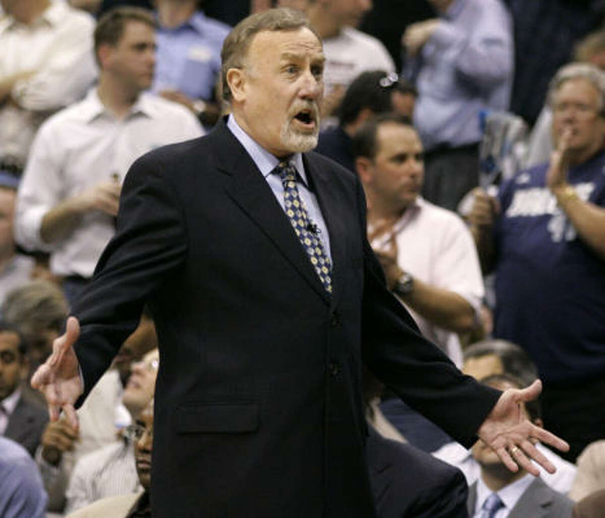 Rockets coach Rick Adelman yells toward the court during the second half.