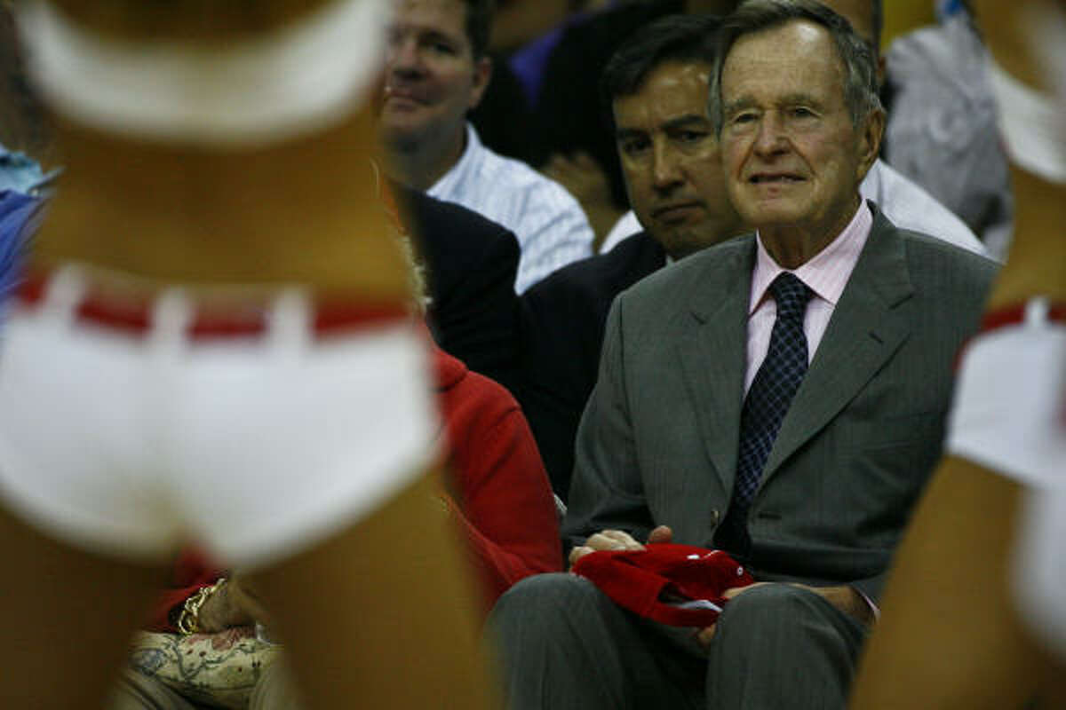 Former President George Bush reacts to the Houston Rockets Power Dancers.