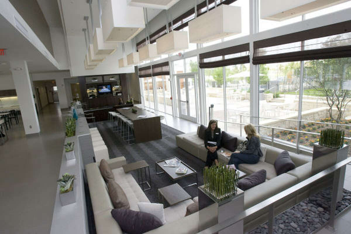 The lobby includes natural light, couches and chairs made of recycled materials, and recycled flooring.