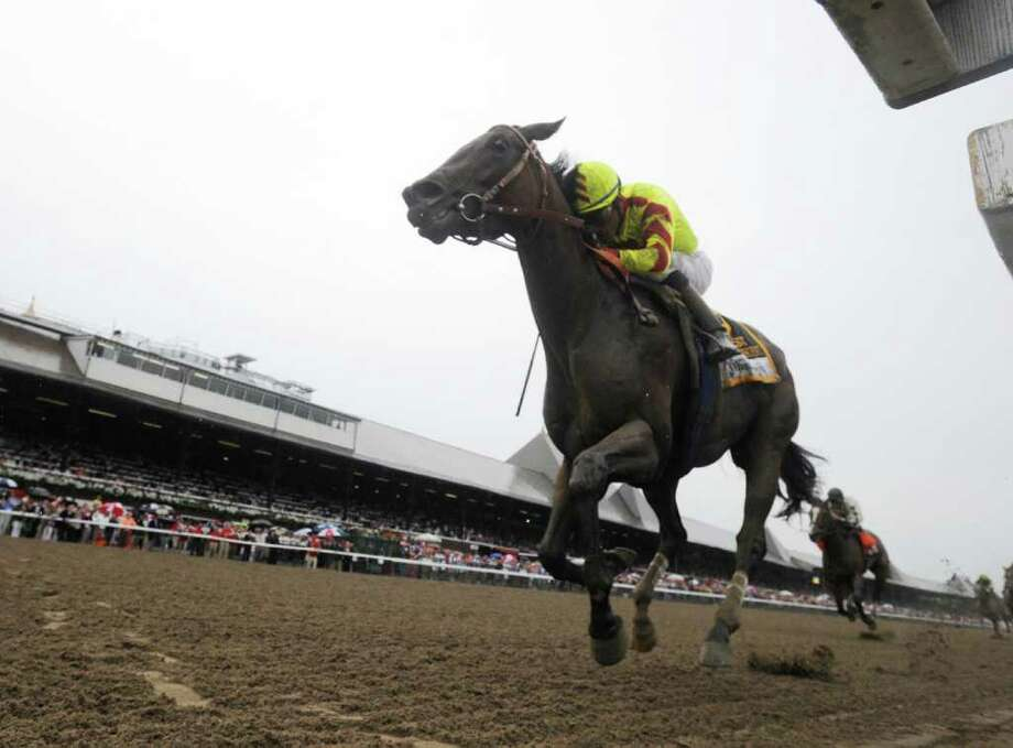 Turbulent Descent with jockey David Flores wins the 86th running of the Test Stakes at the Saratoga Race Course in Saratoga Springs, N.Y. August 6, 2011.       (Skip Dickstein / Times Union) Photo: SKIP DICKSTEIN