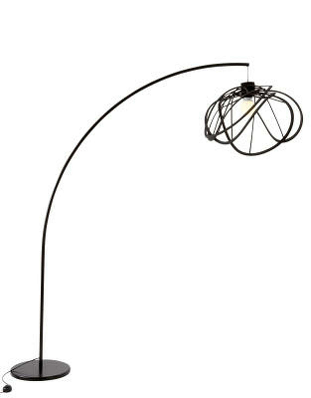 The floor lamp, $845, is anchored by a circular base and a thin, gracefully arching metal stem. Both ceiling and floor versions are available in black or white.