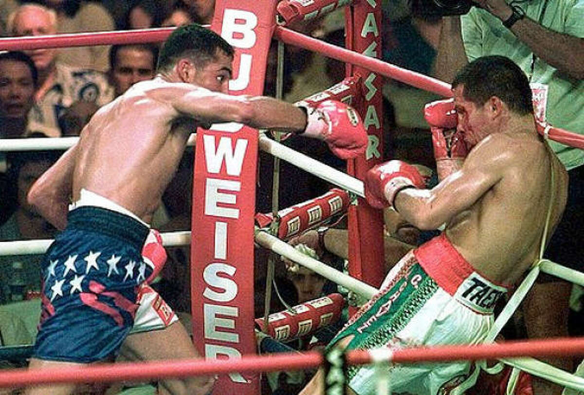 Oscar De La Hoya won a world title in a third weight class with his fourth-round technical knockout of Julio Cesar Chavez in a WBC super-lightweight championship bout on June 7, 1996, at Caesar's Palace in Las Vegas.