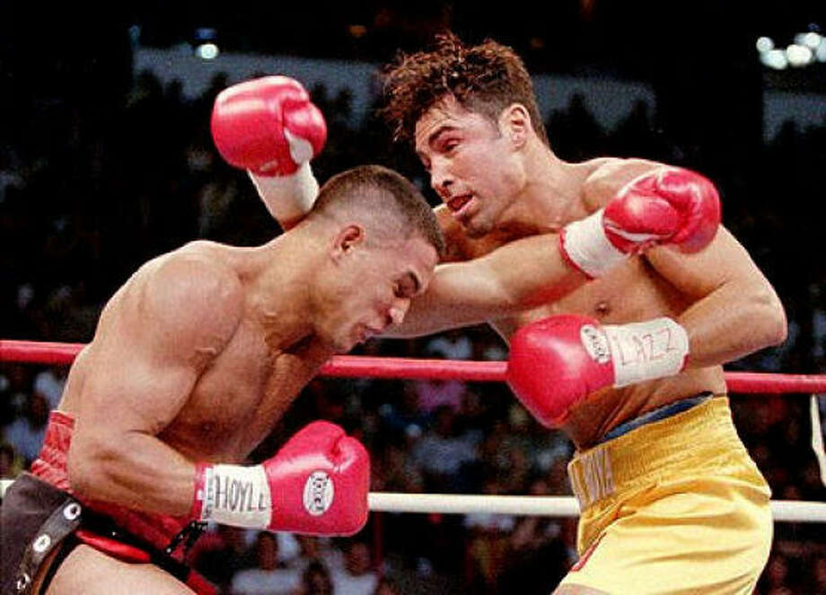 Oscar De La Hoya continued his march through big-name fighters on Sept. 13, 1997, with a unanimous decision over Hector Camacho in a WBC welterweight championship bout. Photo: AP