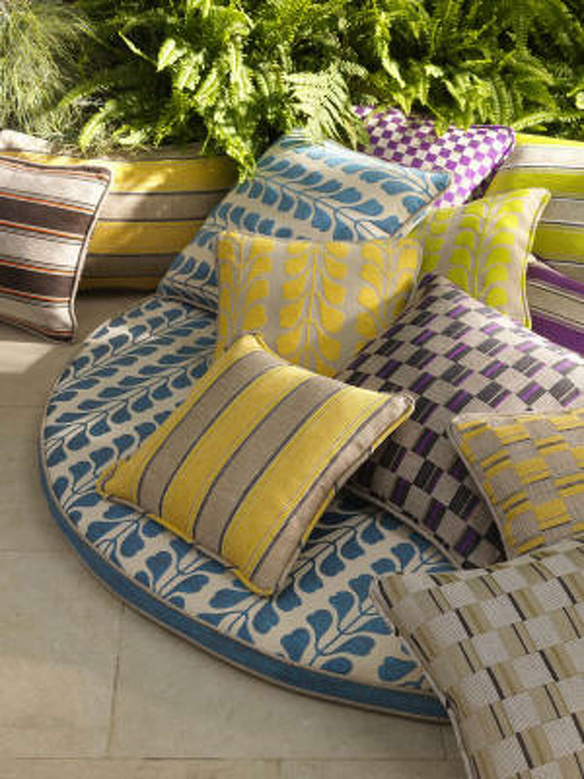 Jane Brown uses solid neutral fabrics for outdoor furniture so she can easily update with new accent pillows in the latest colors and patterns.