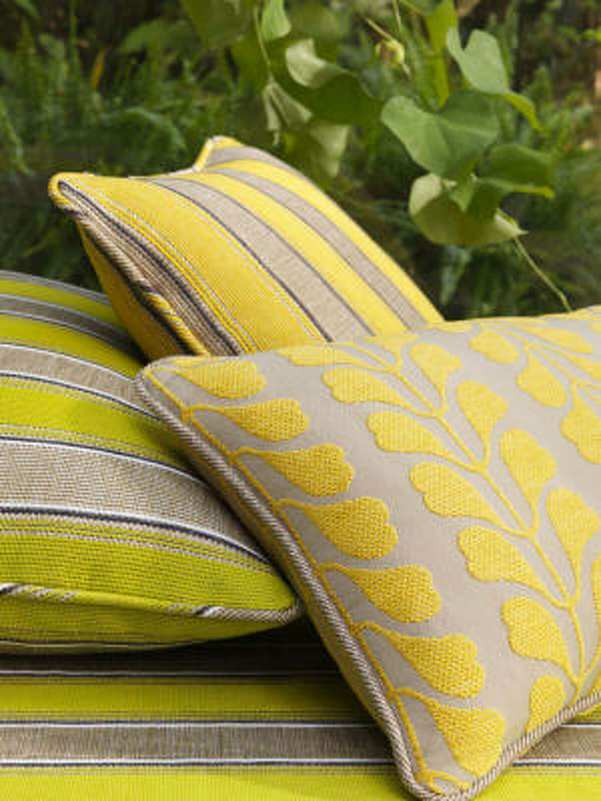 It works well to repeat the colors in the garden. Brown prefers stronger, more graphic patterns in exterior spaces, such as this new Zancudo line of outdoor fabrics from Osborne & Little.