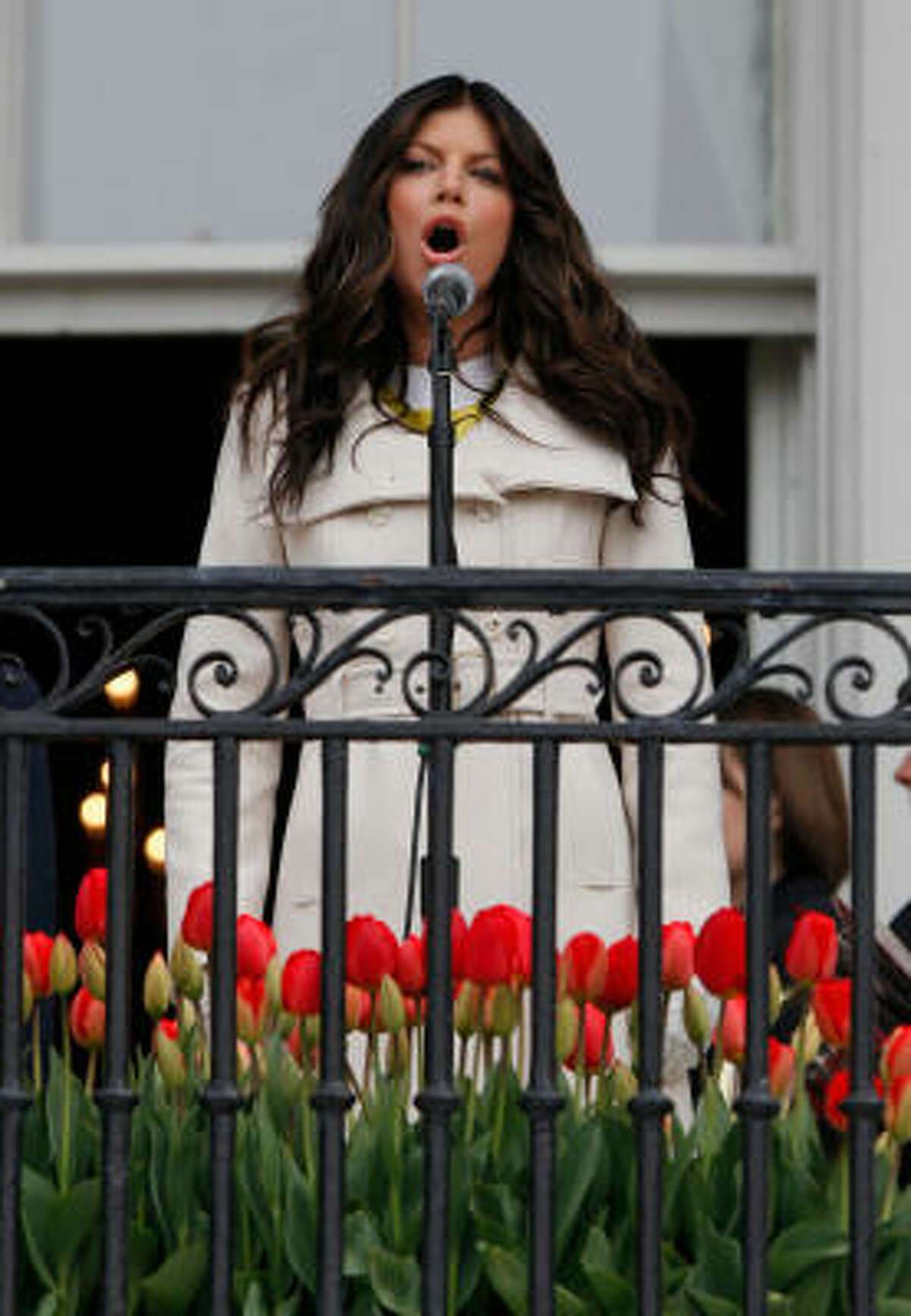 Singer Fergie sings the National Anthem as she takes part in the annual Easter Egg Roll at the White House in Washington.