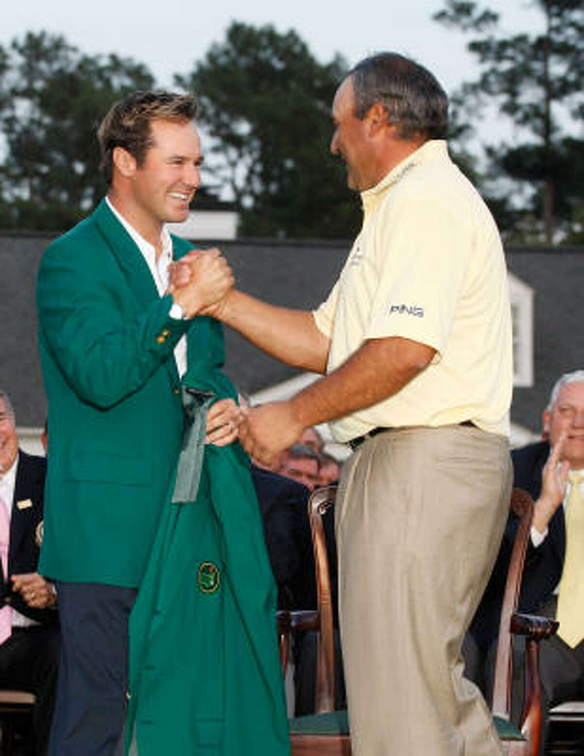 Trevor Immelman of South Africa congratulates Angel Cabrera of Argentina after Cabrera defeated Kenny Perry on the second sudden death playoff hole to win the 2009 Masters Tournament.