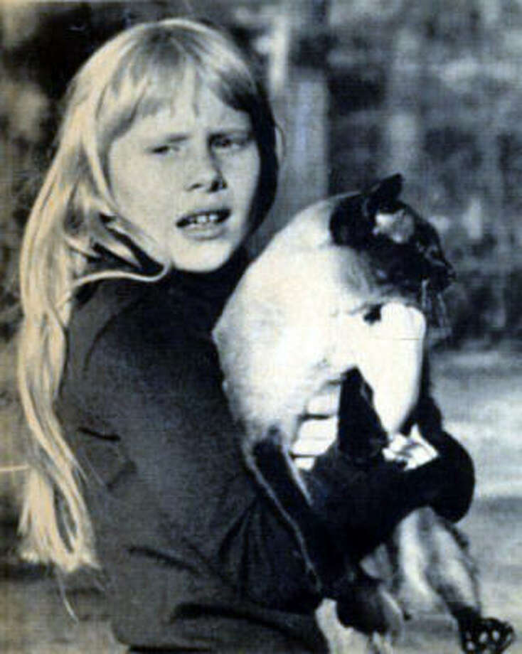 Amy Carter had a Siamese cat named Misty Malarky Ying Yang when her dad, Jimmy Carter, was president. Amy also received a dog named Grits from her teacher, but he was returned. Photo: AP