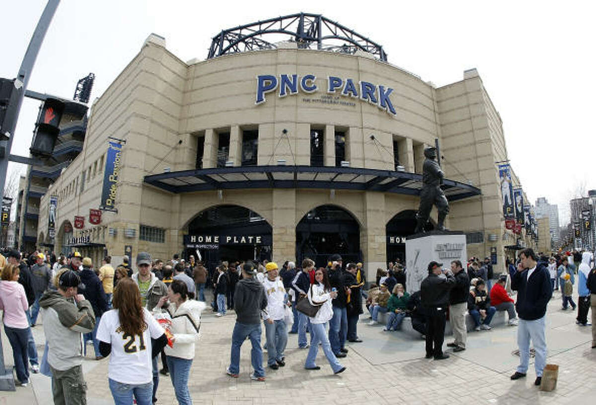Fans mill around outside PNC Park before the Pirates' home opener.