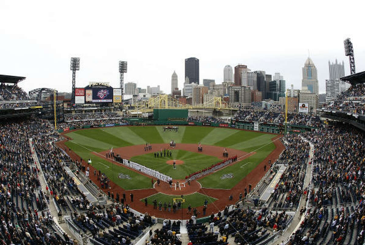 The Pirates and Astros wait to play ball during the national anthem during the Pirates' home opener at PNC Park.