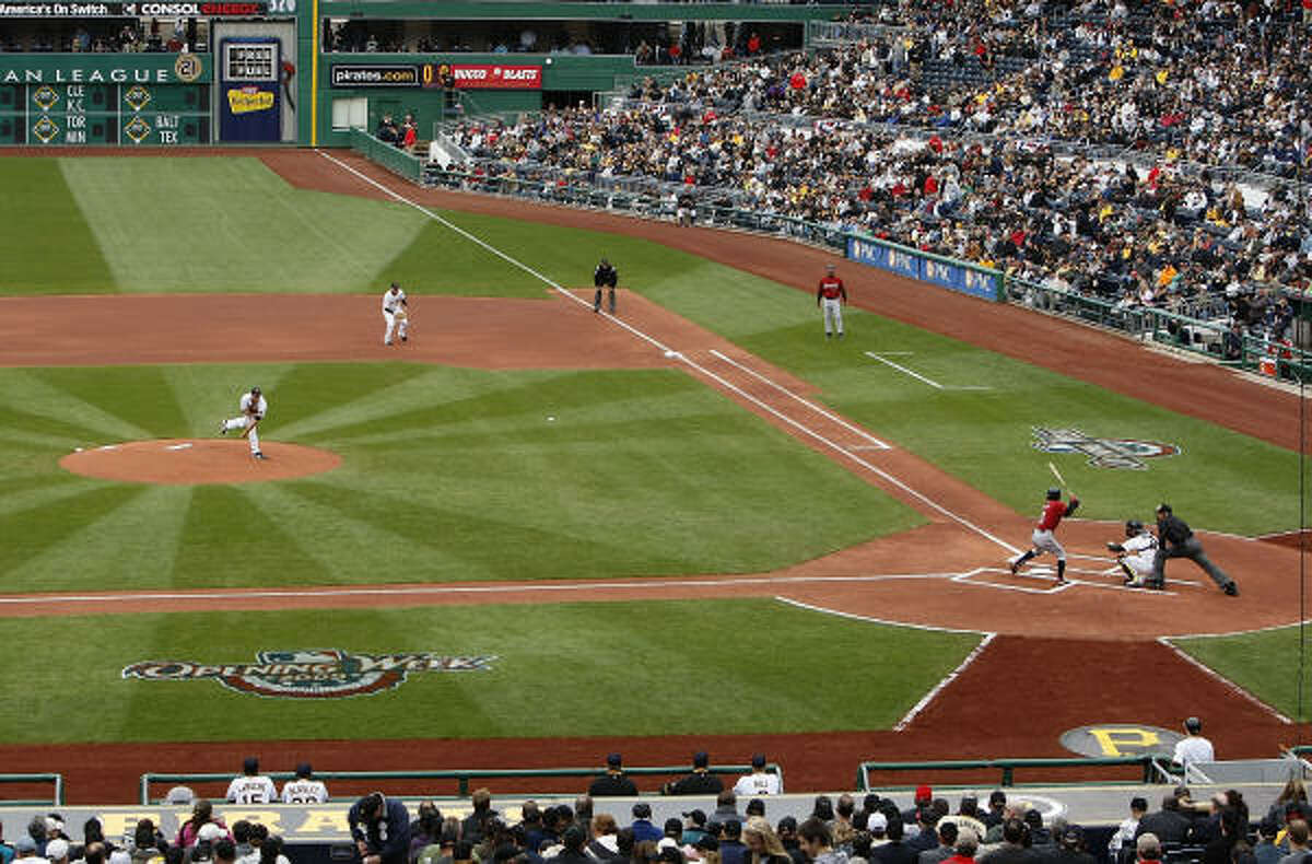 Pirates starter Zach Duke throws the game's first pitch to Kaz Matsui.