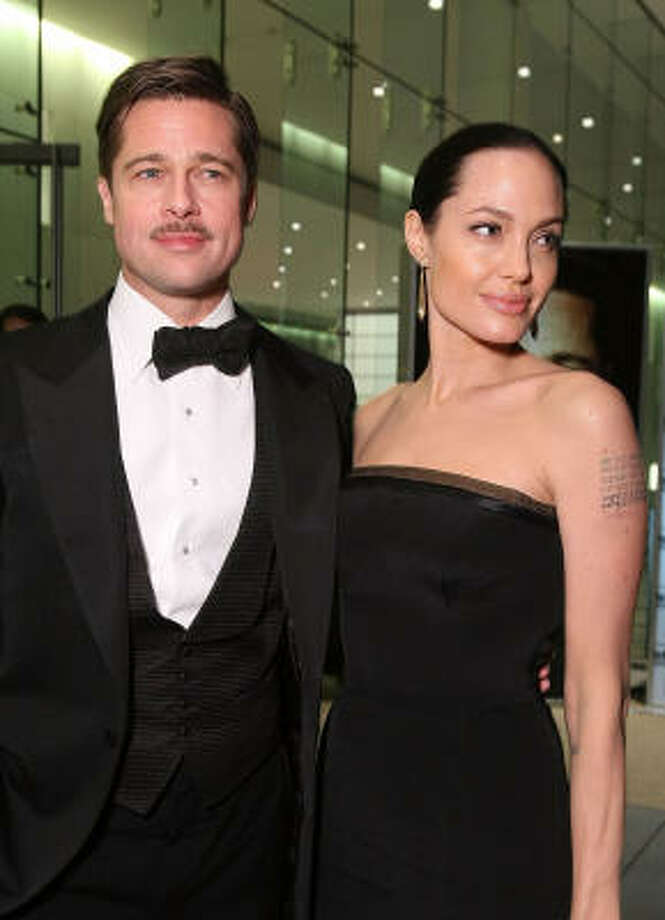 In one of the most publicized births of the year, Brad Pitt and Angelina Jolie welcomed twins to their family in July. Photo: Alexandra Wyman, Getty Images For Belstaff