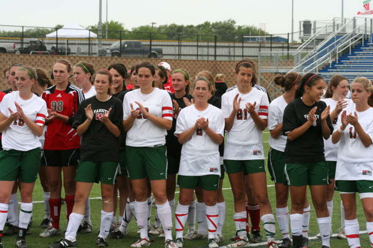 The Woodlands girls clap for Clear Lake after they take third place in state.