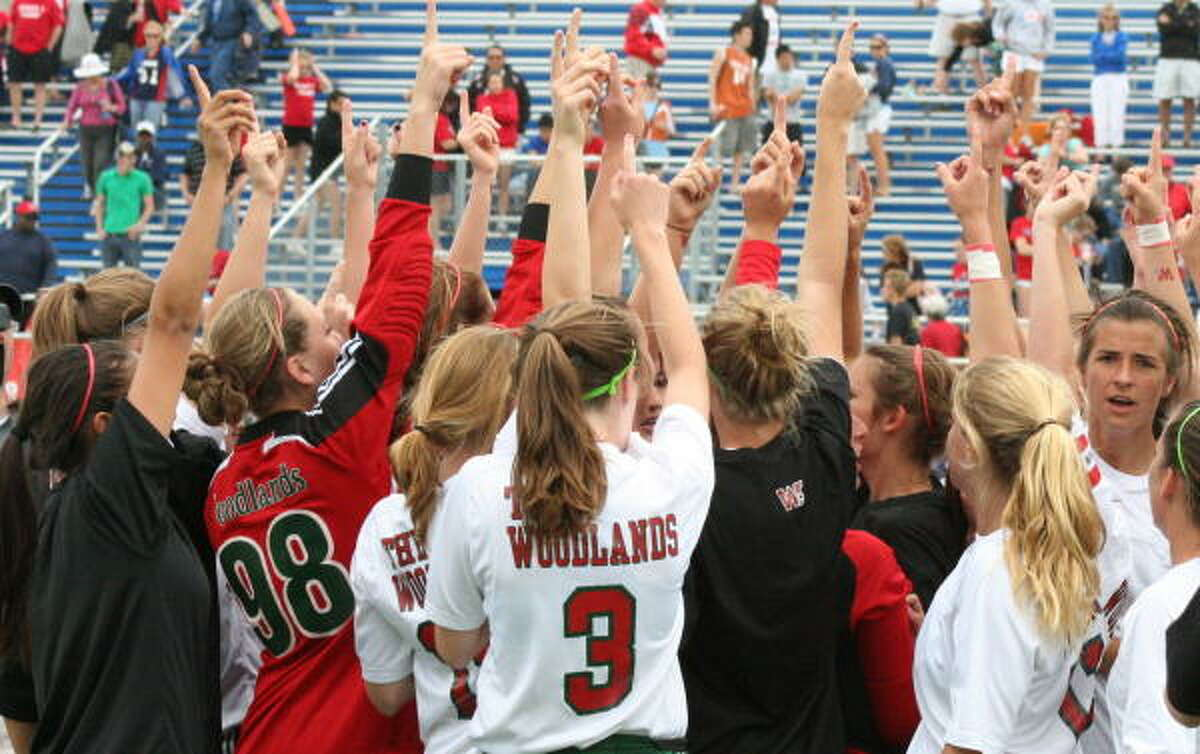 The Woodlands girls put one finger up to say one more game after the 2-0 win over Clear Lake in the semifinals.
