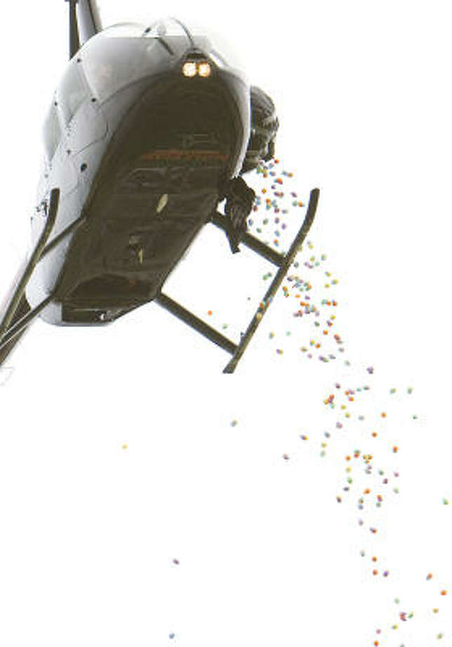 A helicopter dumps 20,000 easter eggs for theThe Great Easter Egg Drop, organized by Crosspoint Fellowship Church in Pearland Stadium. Photo: Nick De La Torre, Houston Chronicle