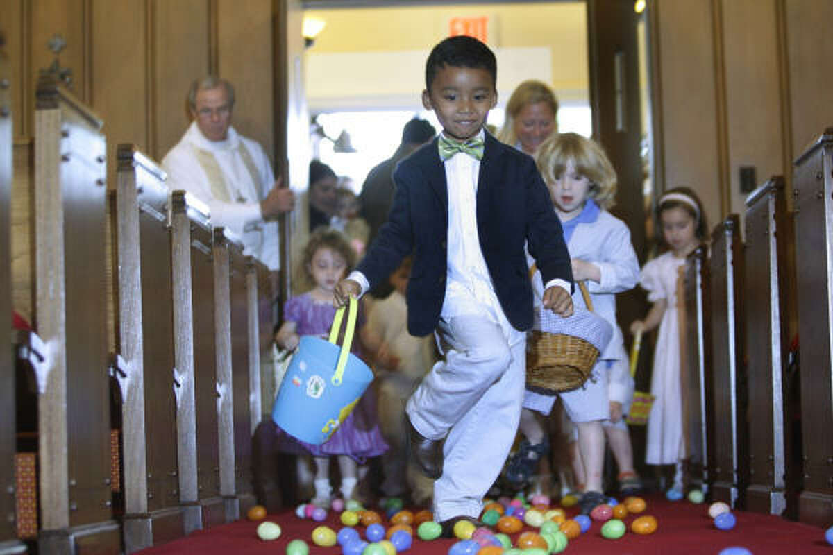 Trey Al-Uqdah runs into the chapel for the Easter egg hunt after attending services at The Church of St. John the Divine.