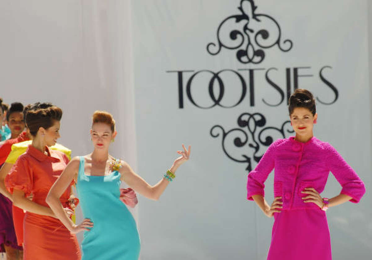 Models walk the runway at the River Oaks tennis luncheon.