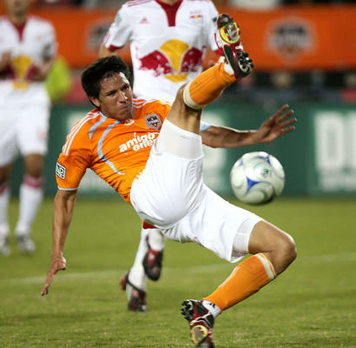 Dynamo forward Brian Ching just misses a shot on goal during the second half.