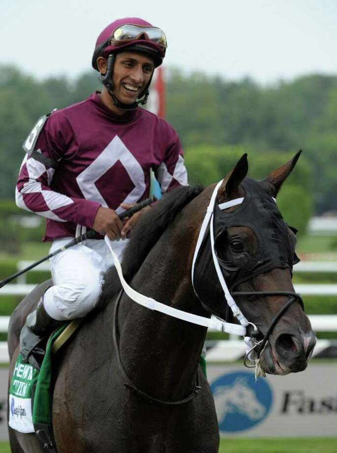 Tizway with jockey Rajiv Maragh returns to the winner's circle after winning the 84th running of The Whitney  Stakes at the Saratoga Race Course in Saratoga Springs, N.Y. August 6, 2011.       (Skip Dickstein / Times Union) Photo: SKIP DICKSTEIN