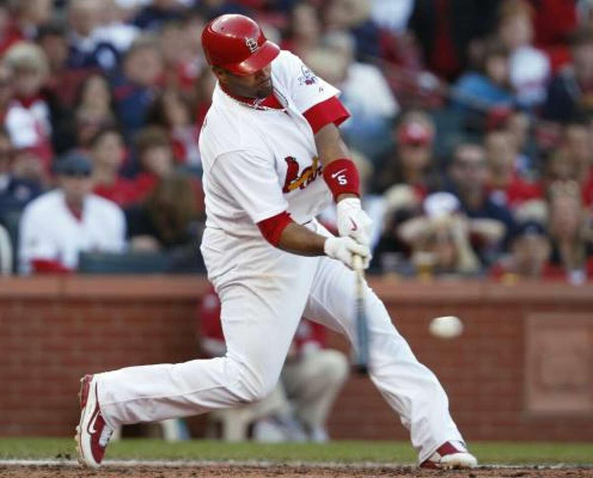 St. Louis Cardinals first baseman Albert Pujols connects for a three-run home run, his second of the game, in the seventh inning. Pujols had 7 RBIs as the Cardinals beat the Astros 11-2.