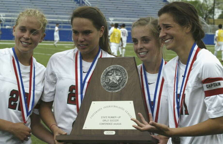 Some of The Woodlands players hold the second place trophy after the 3-2 loss to Coppell. Photo: Gerald James, For The Chronicle