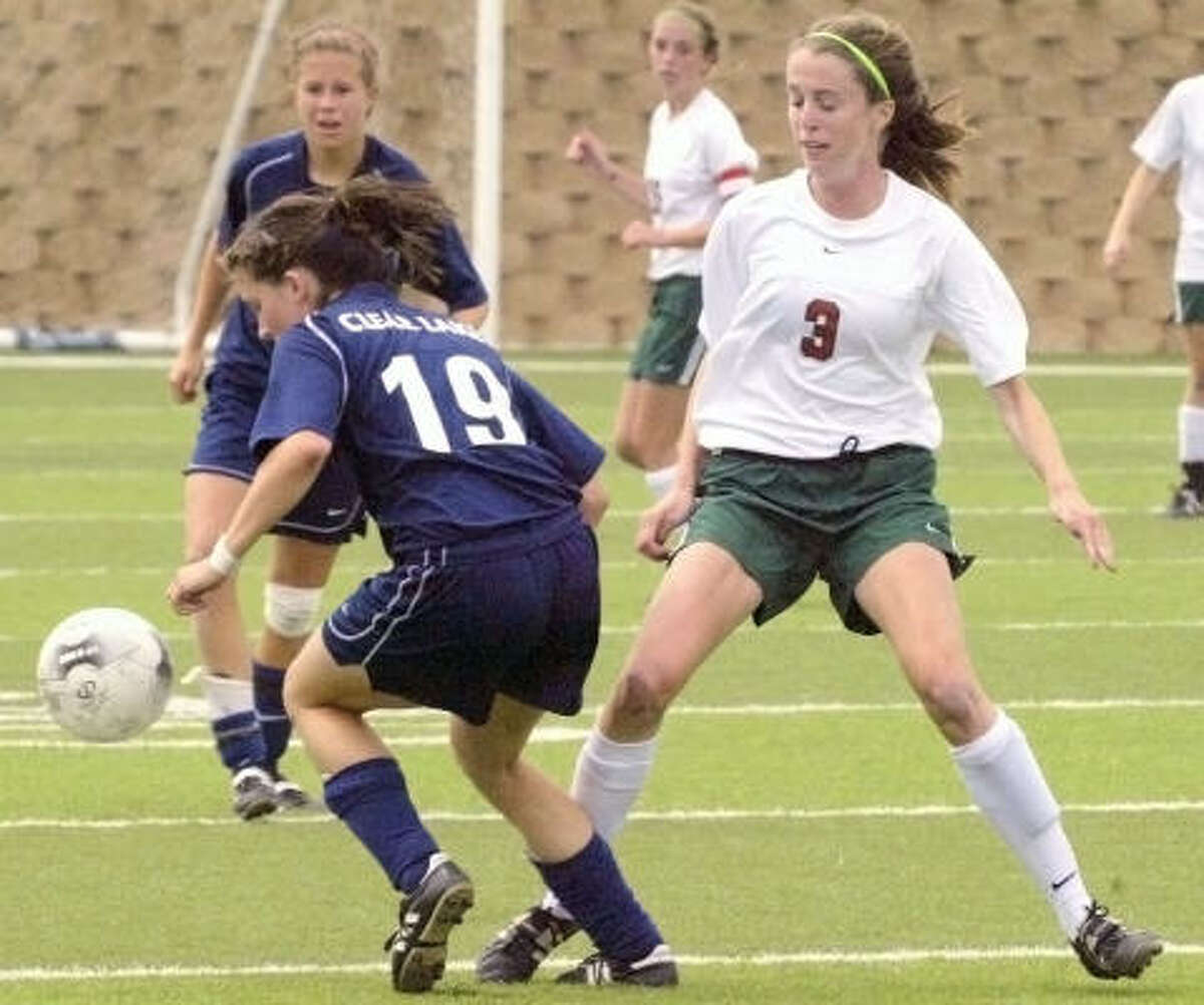 Clear Lake's Tori Sample, left, tries to maintain control in front of Molly Missimer of The Woodlands.