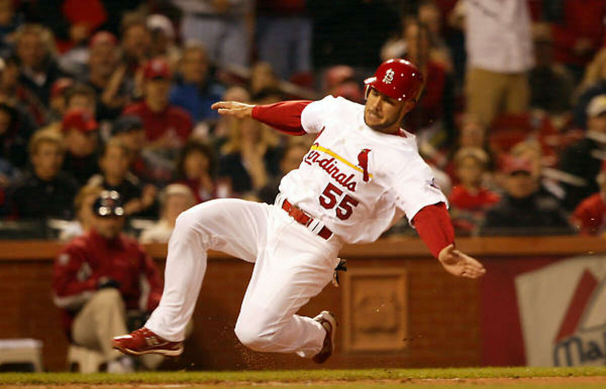 St. Louis Cardinals second baseman Skip Schumaker slides into home plate in the bottom of the first inning on a double by outfielder Chris Duncan.