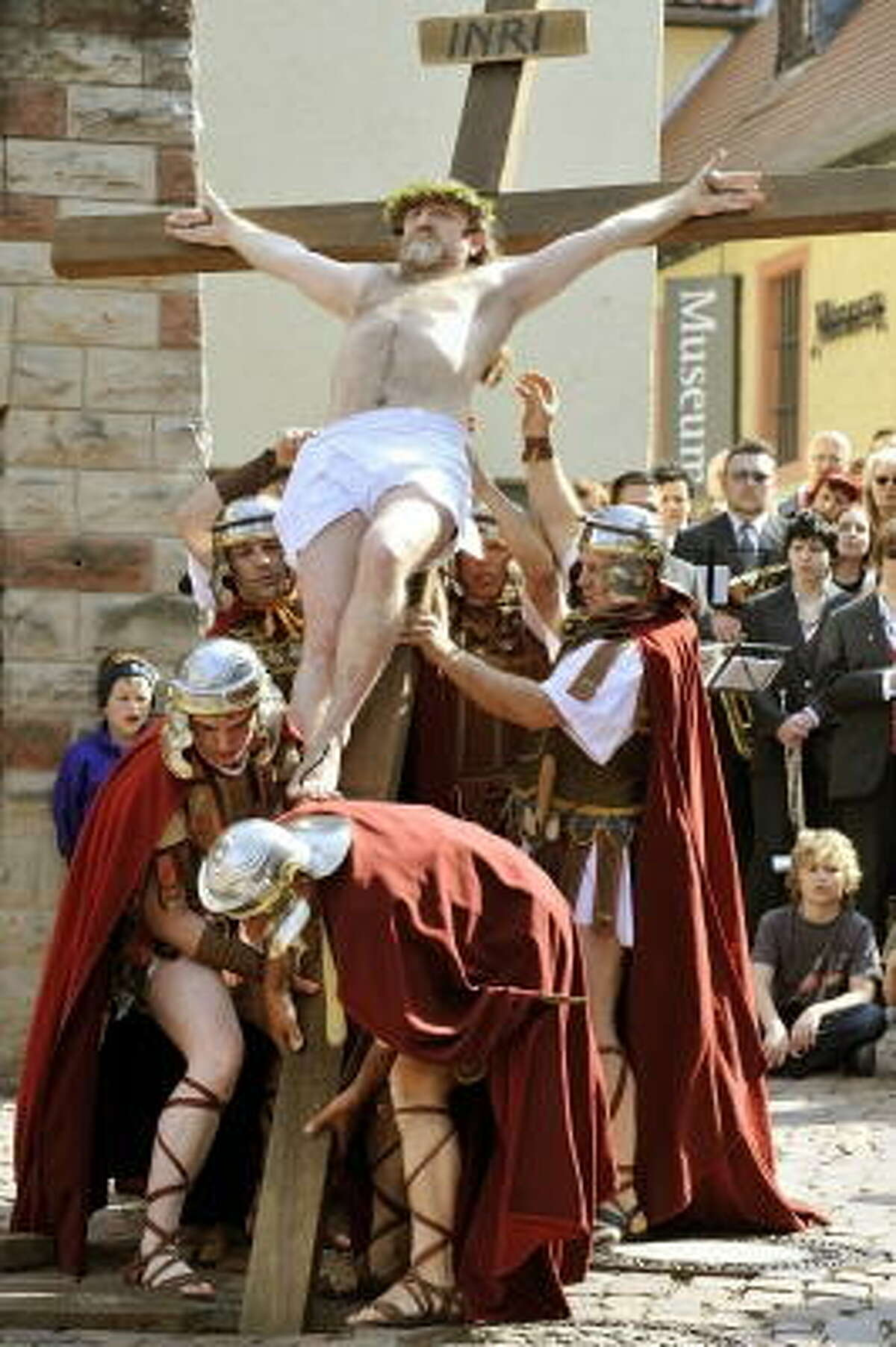 Hartmuth Lux in the role of Jesus and other lay actors perform the Stations of the Cross during the Good Friday procession on April 10, 2009 in Bensheim in western Germany. Thousands of believers flocked the roads of the village to attend the passion play.