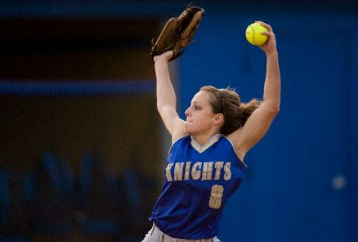 Elkins' Nicole Gremillion throws a pitch during Thursday's game against Clements. Elkins won 5-1.