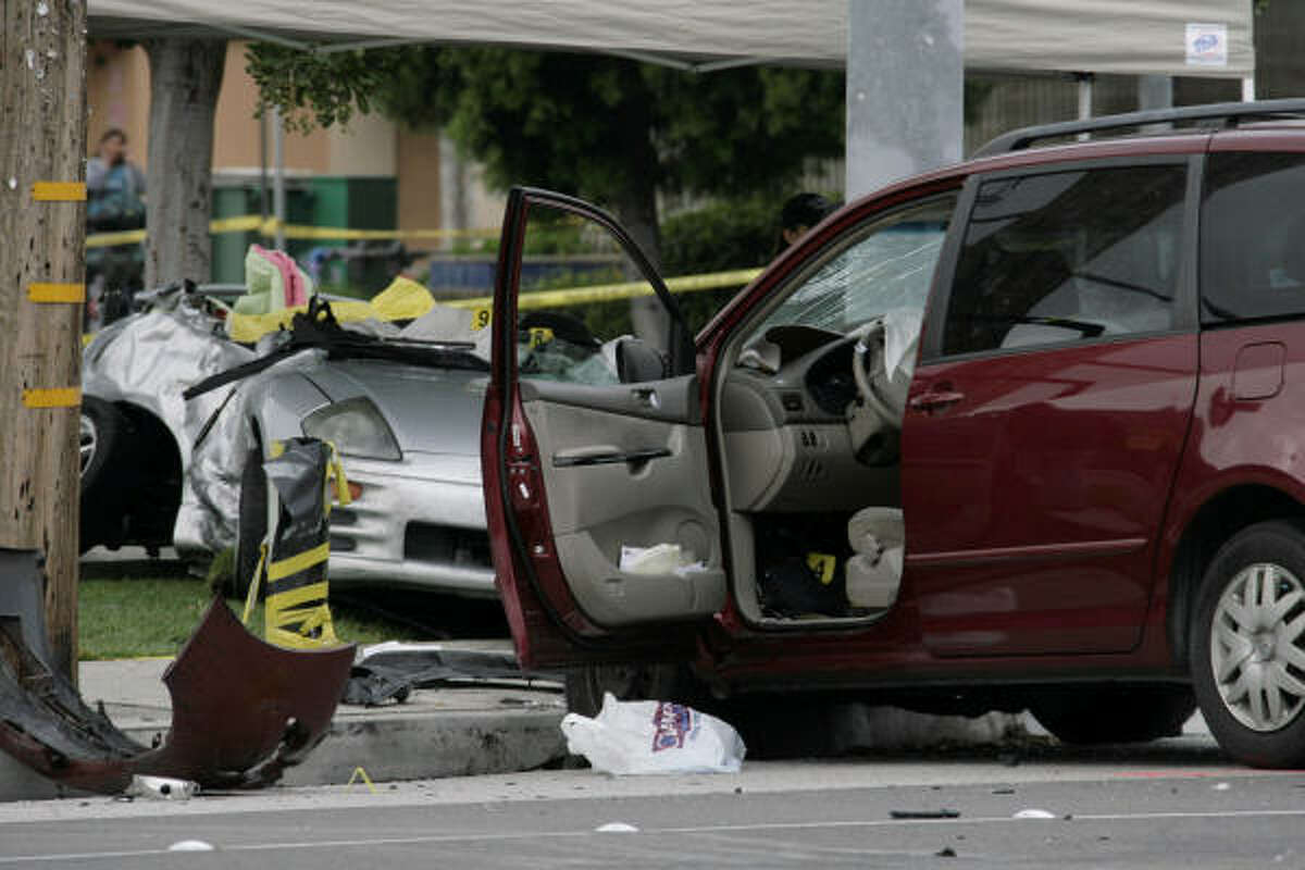 The red minivan, right, that hit the sports car of Los Angeles Angels rookie pitcher Nick Adenhart is shown at the scene.