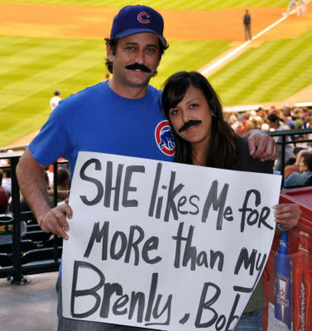 Mark Smith and Melissa Ybarra have a little fun with their matching mustaches.